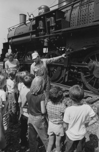 Tom O'Brien Jr. explaining locomotive to children