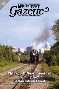 Cover of Mid-Continent Railway Gazette No. 46, No. 4. The issue recounts the C&NW 1385's travels around the Upper Midwest in 1983. Cover photo by Brian Allen shown is the 1385 leaving the Wisconsin State Capitol behind on Sept. 6, 1983.