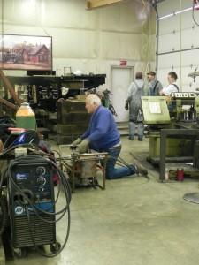 volunteer operating hydraulic jack