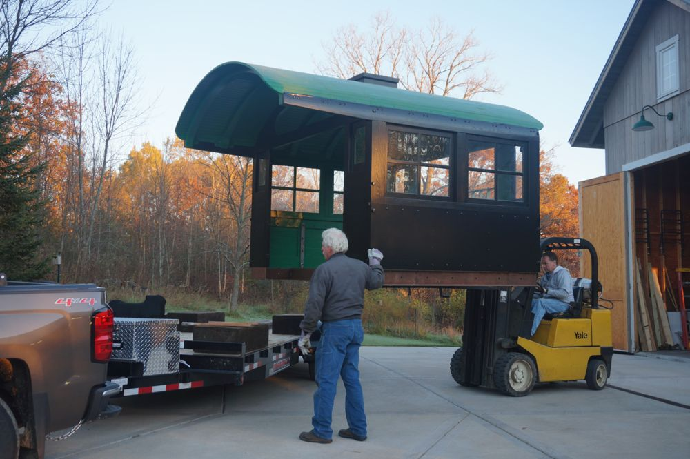 Forklift carrying locomotive cab