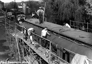 Roofing work on coach car in 1984.