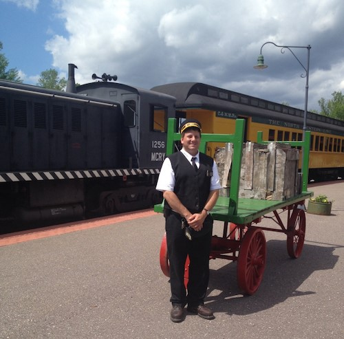 Conductor next to baggage cart