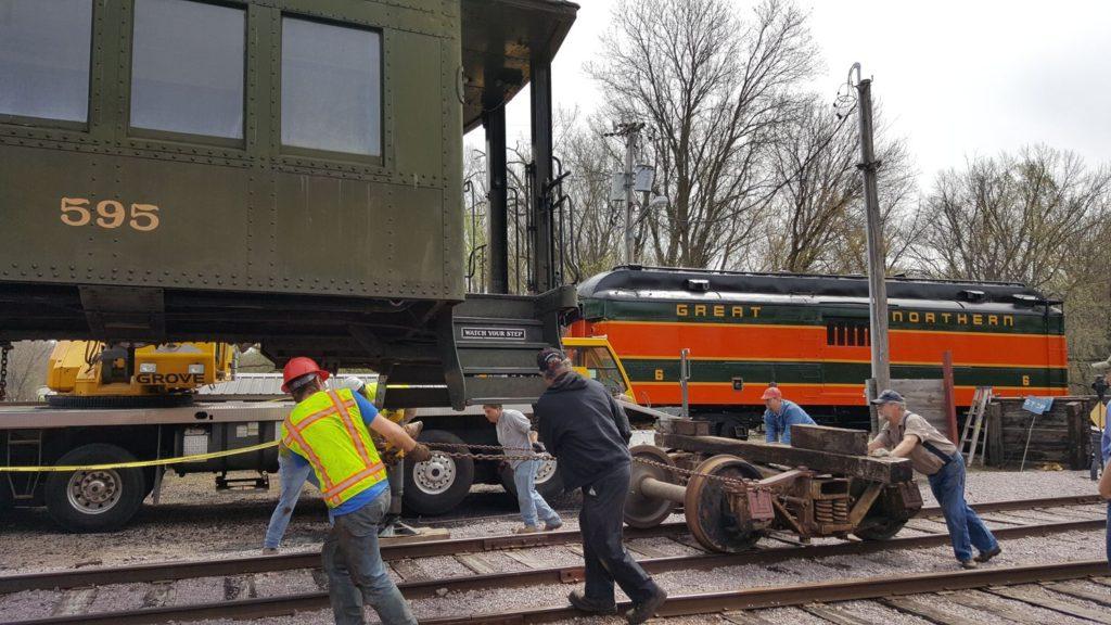 Volunteers pulling a truck under DL&W 595