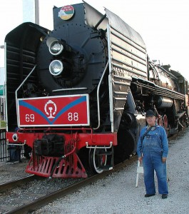 Van McCullough next to Iowa Interstate QJ locomotive