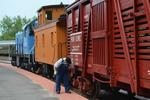 Trainman inspecting train.