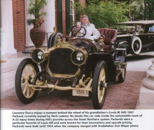 Laurence Dorcy behind wheel of 1907 Packard