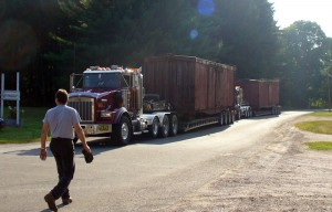 Two LS&I boxcars arrive on three semis from Ishpeming, MI on July 19, 2007.