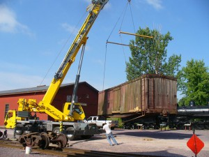 A crane unloads LS&I boxcar #2011 at North Freedom on July 19, 2007. Jim Connor photo.