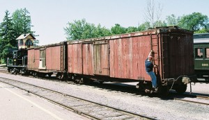 LS&I boxcars #2026 (behind locomotive) and #2011 upon delivery at North Freedom, July 19, 2007. Jim Connor photo.