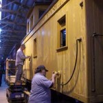 volunteers sanding caboose