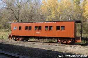 exterior view of drovers caboose in Mid-Continent's train yard