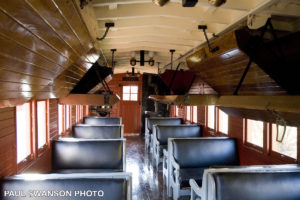 interior view of drovers caboose showing seating and above-seat sleeping berths in the lowered position