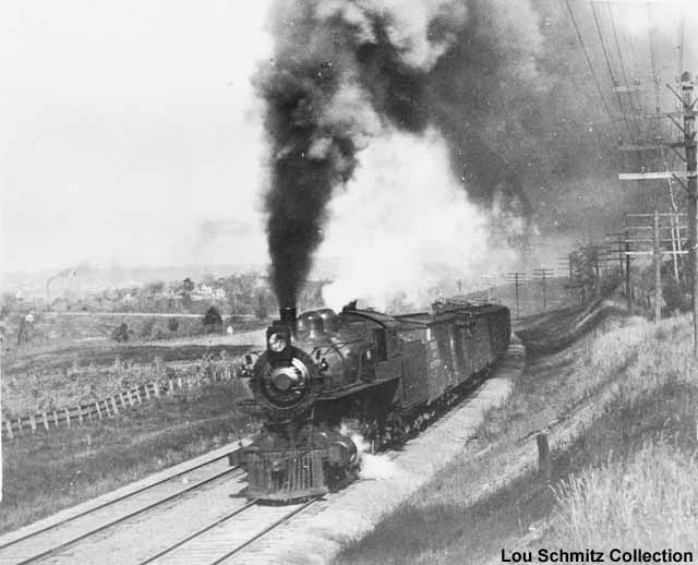 An eastbound freight behind a C&NW Class R-1 4-6-0 locomotive (sister to #1385) blasts out of Baraboo toward Devils Lake in 1906. Photo from the collection of Lou Schmitz.