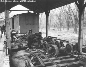 putting narrow gauge C&NW boxcar under display shed roof, no date; R.A. Greiner photo; MCRM collection