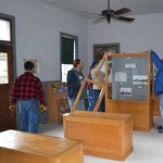 volunteers installing display cases