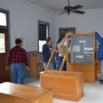 volunteers installing display cases
