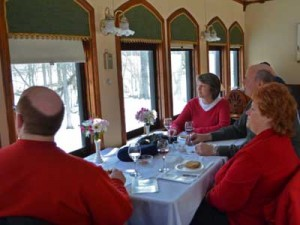First Class ticket holders enjoy hors d' oeurves and drinks from onboard a 1929 Pullman car.