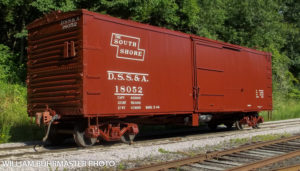 Dull red colored boxcar with The South Shore stylized logo and reporting marks of DSS&A number 18052. Photo credited to William Buhrmaster
