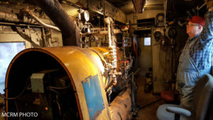 Approximately 10 ft long boiler inside the what was once a baggage room. A volunteer is monitoring boiler pressure gauges. Photo credited to Mid-Continent Railway Museum.
