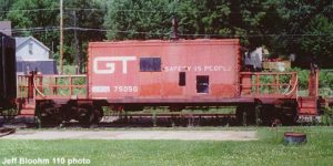Red caboose with boxcar-like center and large platforms on both ends. It has a styled logo GT logo. MCRM reporting marks are spraypainted on next to its number, 75050.