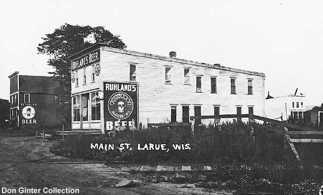 """A view of """"downtown"""" LaRue, looking east from the present-day location of County Highway PF's crossing of the tracks."""