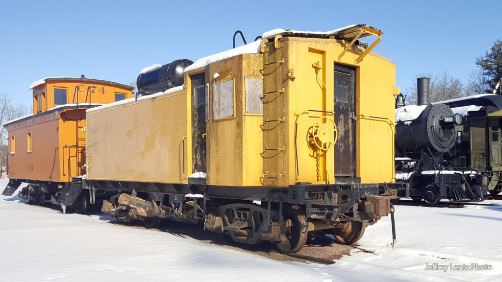 Front corner view of Milwaukee Road #X900291 flanger.