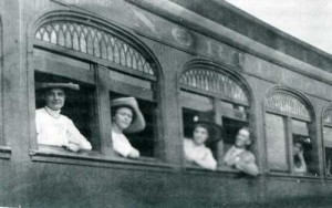 Passengers looking out passenger car windows
