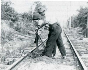trackmen operating rail drill